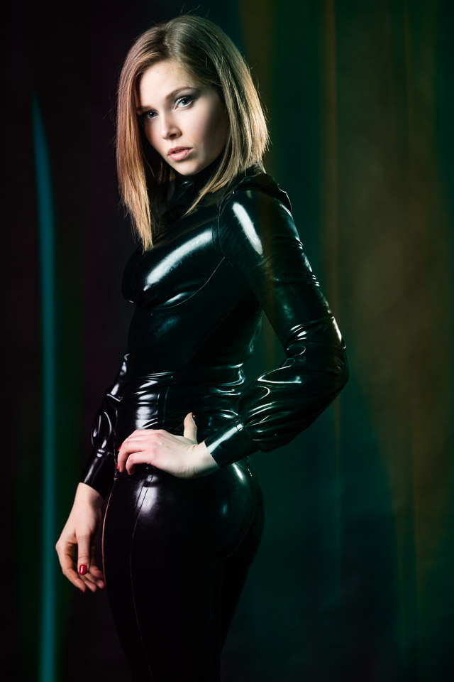 Joke in a Black Latex Outfit