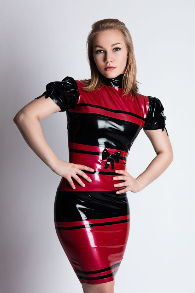 Imke in a Red and Black Westward Bound Latex Dress
