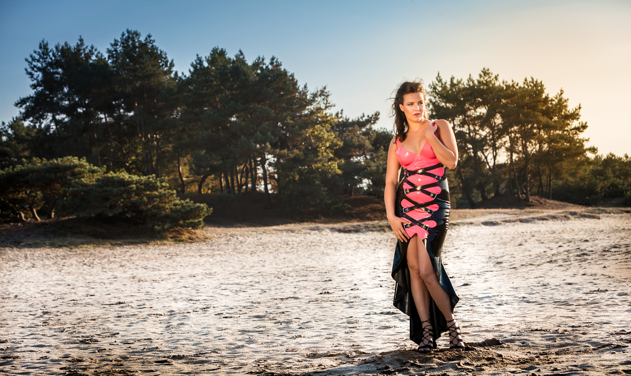 Eva Catches the Last Rays of Sun in a Latex Gown by Inner Sanctum