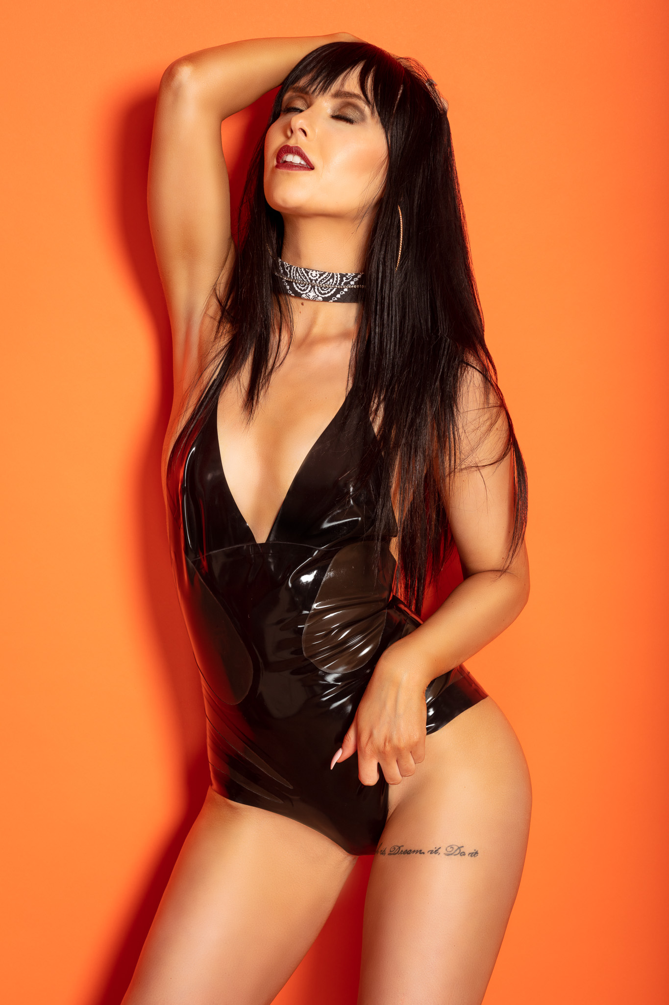 Orange Is The New Black with Model Jolien in Shiny Latex